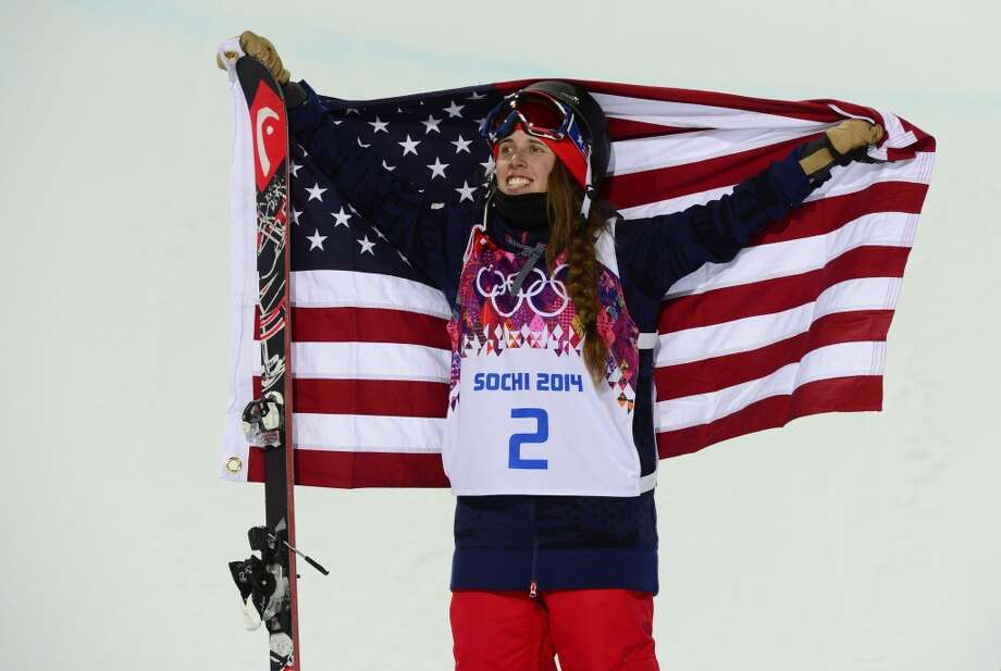 Gold Medallist, US Maddie Bowman celebrates at the Women's Freestyle Skiing Halfpipe Flower Ceremony at the Rosa Khutor Extreme Park during the Sochi Winter Olympics on February 20, 2014. Photo: JAVIER SORIANO, AFP/Getty Images