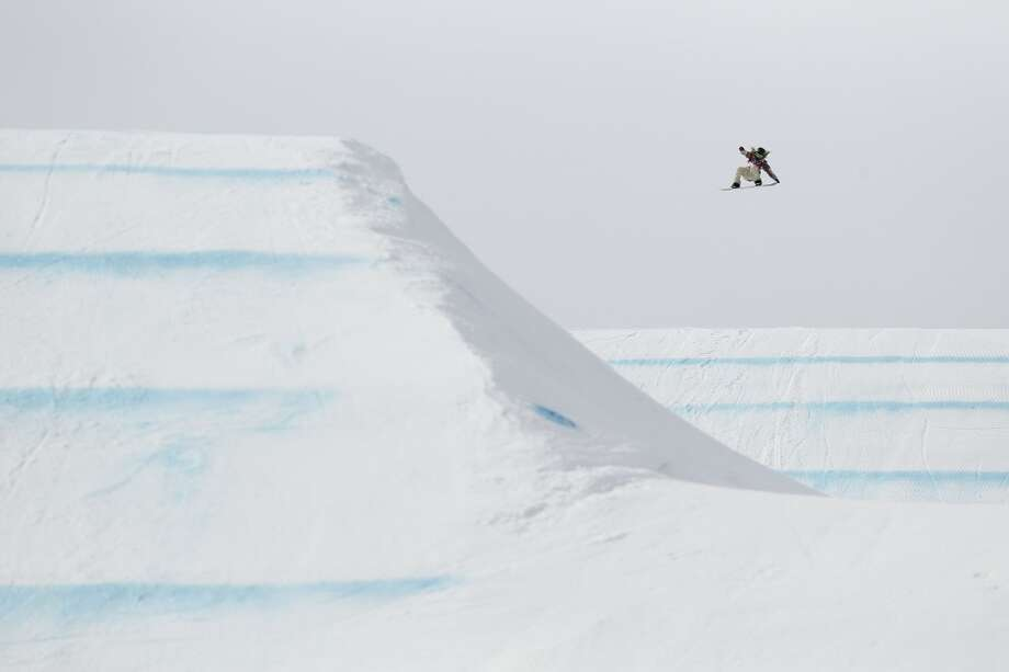 Jamie Anderson (USA) executes a jump on her winning final run in the ladies slope style finals during the Sochi 2014 Olympic Winter Games at Rosa Khutor Extreme Park. Photo: Rob Schumacher, Reuters