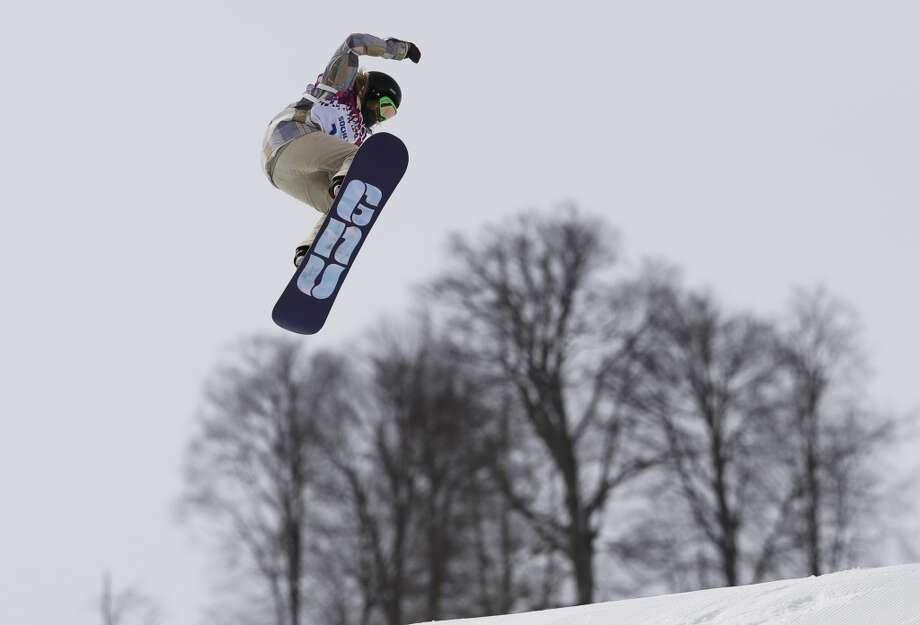 Jamie Anderson of the United States takes a jump on her final run in the women's snowboard slopestyle final at the 2014 Winter Olympics, Sunday, Feb. 9, 2014, in Krasnaya Polyana, Russia. Photo: Andy Wong, Associated Press