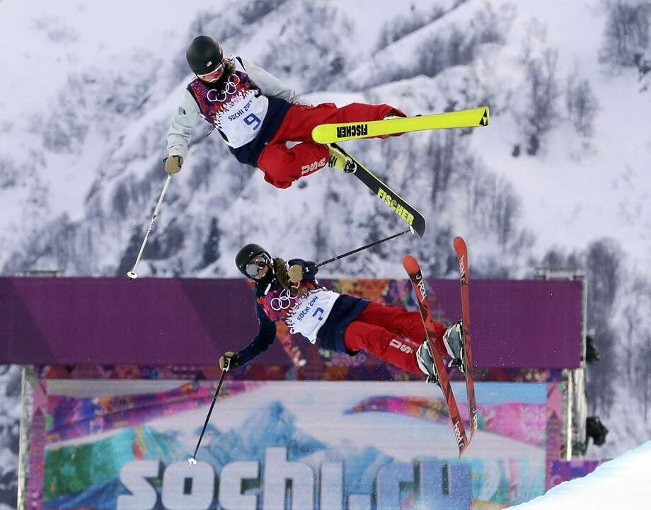 Annalisa Drew of the United States, top, and compatriot Maddie Bowman get air during training ahead of women's ski halfpipe qualifying at the at the Rosa Khutor Extreme Park, at the 2014 Winter Olympics, Thursday, Feb. 20, 2014, in Krasnaya Polyana, Russia. Photo: Andy Wong, Associated Press