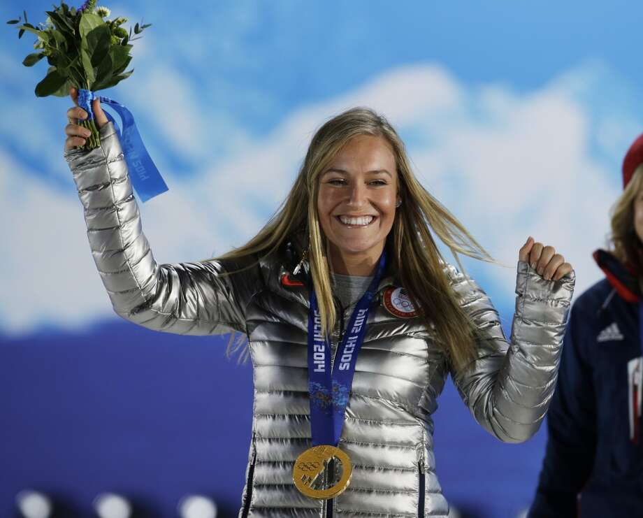 Gold medalist in the women's snowboard slopestyle Jamie Anderson of the United States smiles during the medals ceremony at the 2014 Winter Olympics, Sunday, Feb. 9, 2014, in Sochi, Russia. Photo: Morry Gash, Associated Press