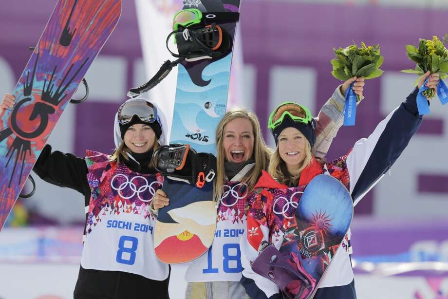 Jamie Anderson of the United States, center, celebrates with silver medalist Enni Rukajarvi of Finland, left,  and bronze medalist  Jenny Jones of Britain, after Anderson won the women's snowboard slopestyle final at the 2014 Winter Olympics, Sunday, Feb. 9, 2014, in Krasnaya Polyana, Russia. Photo: Andy Wong, Associated Press