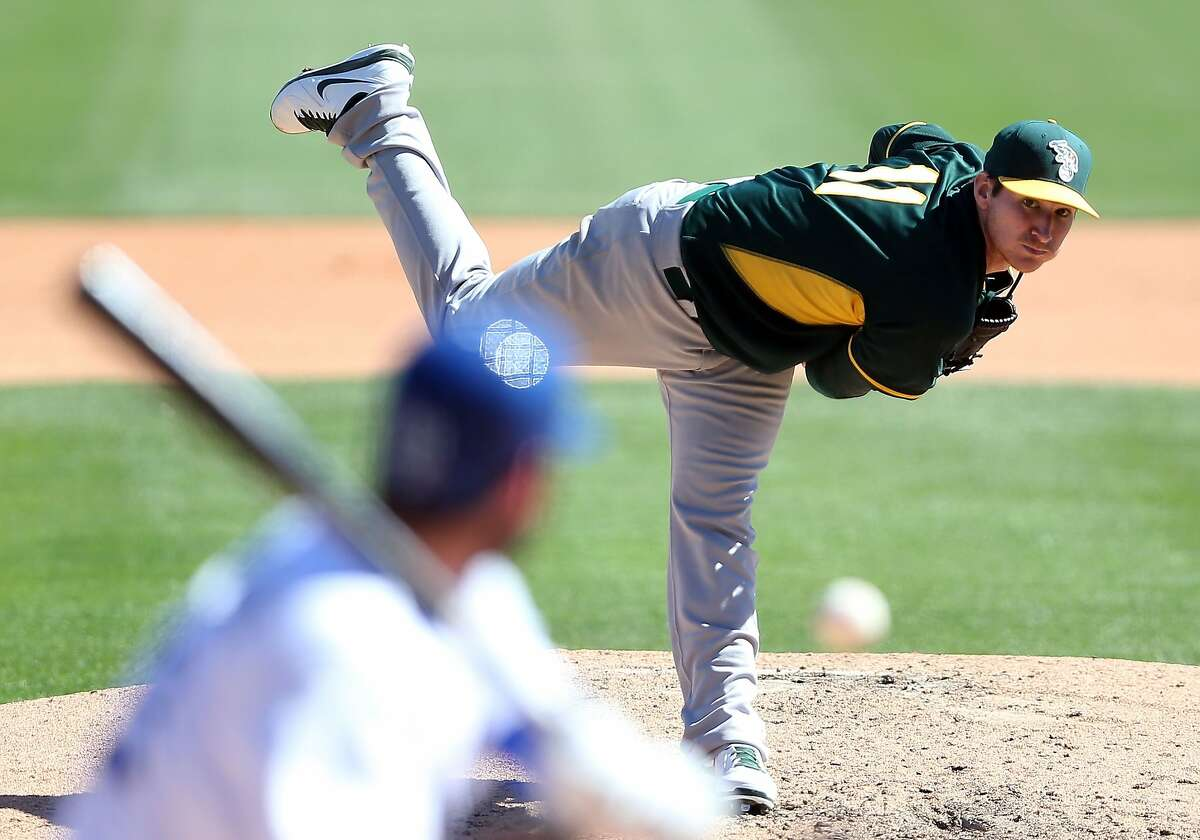GLENDALE, AZ - MARCH 10: Starting pitcher Jarrod Parker #11 of the Oakland Athletics pitches against the Los Angeles Dodgers during the spring training game at Camelback Ranch on March 10, 2014 in Glendale, Arizona. (Photo by Christian Petersen/Getty Images)