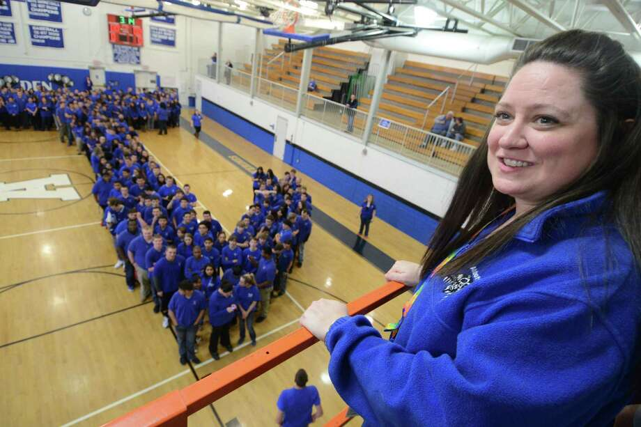 Abbott Tech Principal Stacy L. Butkus looks from above as students and faculty attempt to break the Guinness record for world's largest human Pi symbol in the gym at Henry Abbott Technical School in Danbury, Conn. Friday, March 14, 2014.  448 students and faculty members participated, staying in formation of the math symbol for 15 minutes as several cameras recorded the world record attempt.  The current record is 250 and the school will send the footage to Guinness to be reviewed to the new world record. Photo: Tyler Sizemore / The News-Times