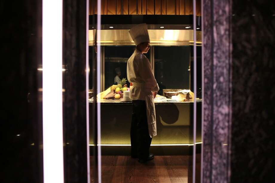 Japan: A chef stands in a restaurant in the Abeno Harukas building, operated by Kintetsu Corp., at dusk in Osaka, Japan, on Tuesday, March 4, 2014. Japan's tallest building will open this week in Osaka, surpassing Landmark Tower near Tokyo, as Asia's third-biggest metropolitan economy aims to lure tourists and businesses and stem moves to the capital. Photo: Yuzuru Yoshikawa, Bloomberg