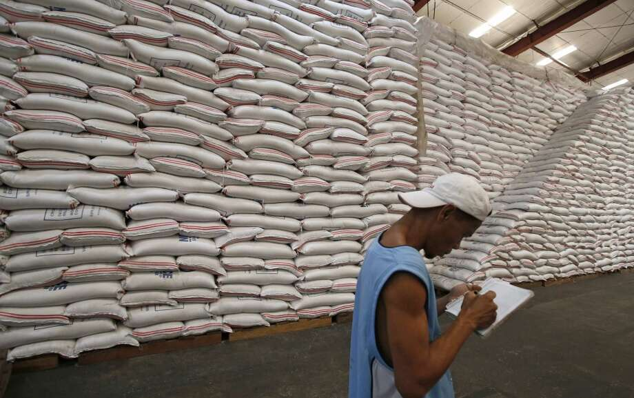 Philippines: A National Food Authority (NFA) worker makes an inventory of rice stocks at a government rice warehouse in Taguig, Metro Manila March 11, 2014. Overall rice stocks in the Philippines fell to their lowest in four months in February, data showed on Monday, increasing pressure on Manila to import more of the national staple. The country has been expected to ship in more rice to boost supply as it battles local prices that have risen for seven straight weeks, with speculation rife on the timing and size of any tender. Photo: ERIK DE CASTRO, Reuters