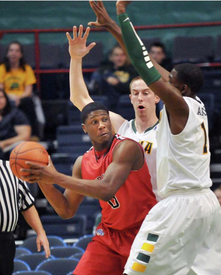 Fairfield's #15 Maurice Barrow, left, gets boxed in by Siena's #31 Owen Wignot and #1 OD Anosike during their MAAC game at the Times Union Center in Albany Friday Jan. 6, 2012.   (John Carl D'Annibale / Times Union) Photo: John Carl D'Annibale, Albany Times Union / Albany Times Union
