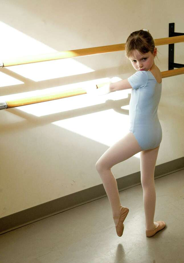 Susannah Lasek practices ballet during a lesson at The Ballet School of Stamford on Thursday, March 14, 2014. The school is a recipient of a grant from the Community Arts Partnership Program. Photo: Lindsay Perry / Stamford Advocate