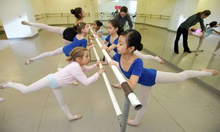 Students practice ballet during a lesson at The Ballet School of Stamford on Thursday, March 14, 2014. The school is a recipient of a grant from the Community Arts Partnership Program. Photo: Lindsay Perry / Stamford Advocate