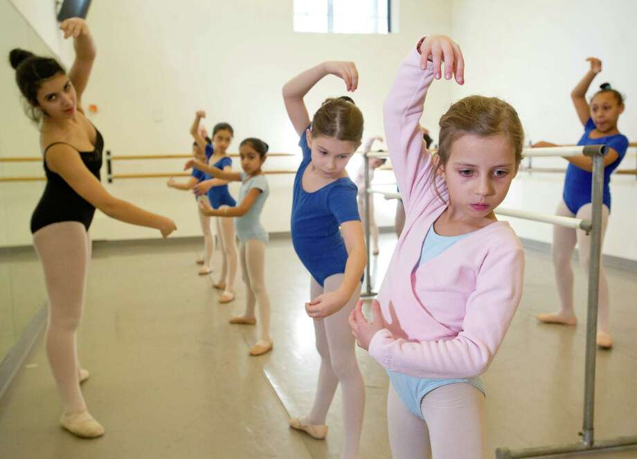 Anya Anderson, far right, practices ballet during a lesson at The Ballet School of Stamford on Thursday, March 14, 2014. The school is a recipient of a grant from the Community Arts Partnership Program. Photo: Lindsay Perry / Stamford Advocate