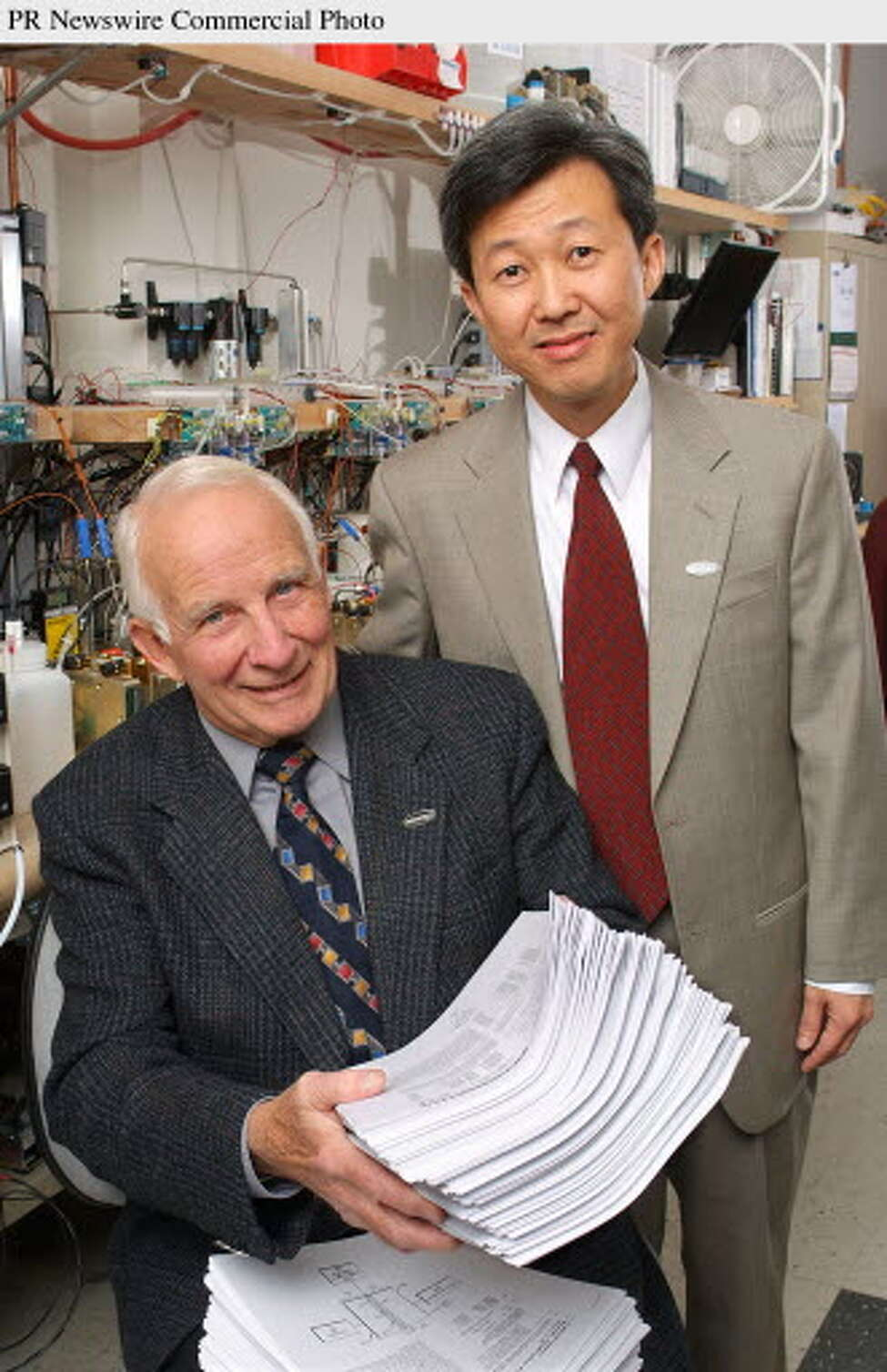 WALTER robb, left, a majority owner of mti micro, could one day control all of the company?s operations. At right is mti micro Ceo Peng Lim. Times Union archive