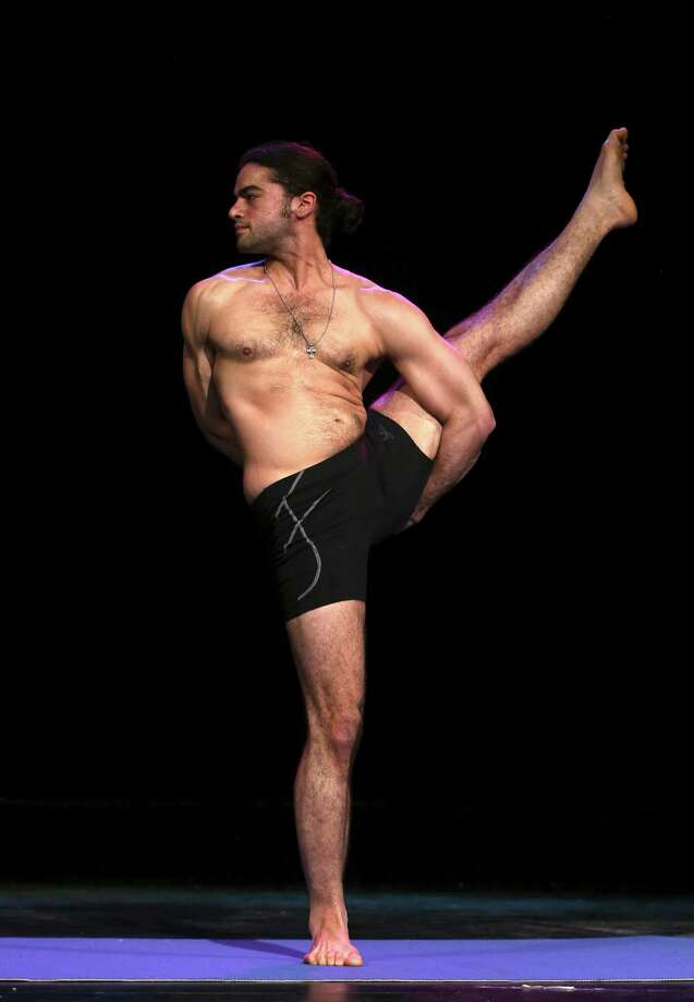 Steven Gonzalez executes the bird of paradise pose at the preliminaries of the 2014 USA Yoga National Championship on Friday March 14, 2014 at Aztec Theatre. Photo: Helen L. Montoya, San Antonio Express-News / ©2013 San Antonio Express-News