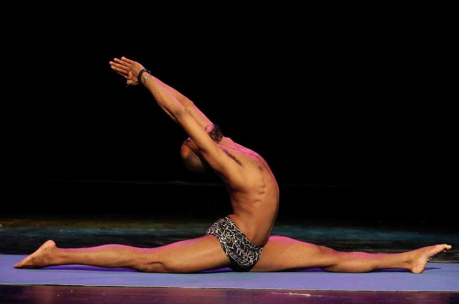 Charles Staples executes the splits at the preliminaries of the 2014 USA Yoga National Championship on Friday March 14, 2014 at Aztec Theatre. Photo: Helen L. Montoya, San Antonio Express-News / ©2013 San Antonio Express-News