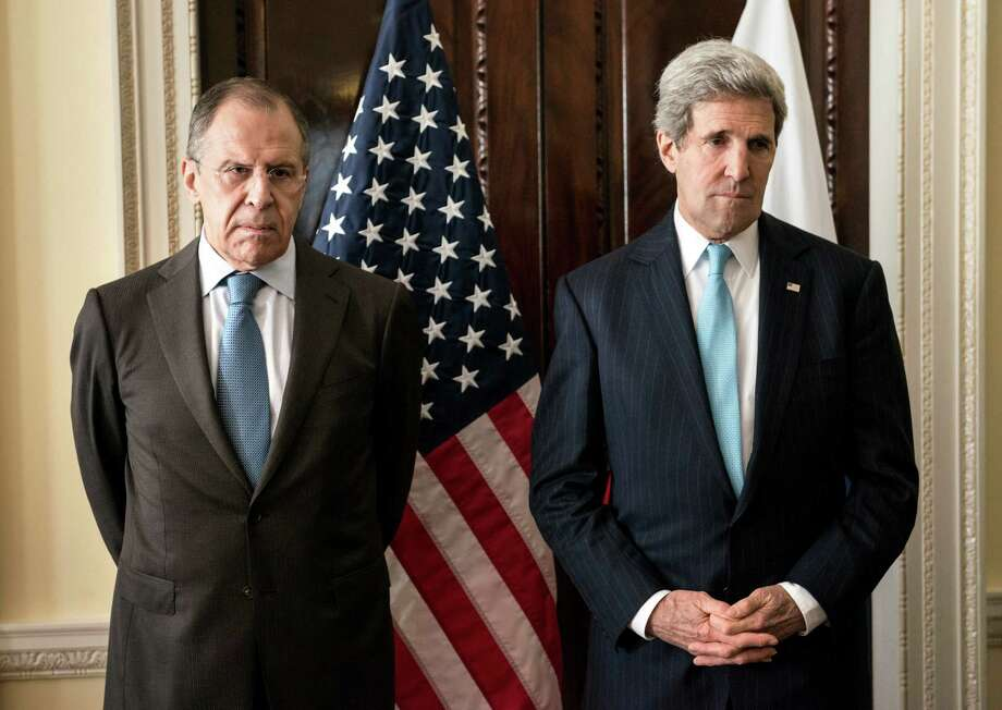 Russian Foreign Minister Sergey Lavrov and Secretary of State John Kerry appear grim in London. Photo: Brendan Smialowski, POOL / AFP Pool