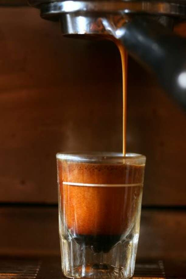 9. New York City, N.Y. - Coffee purist shop, Joe the Art of Coffee (pictured), is one reason why NYC made it into Travel + Leisure's top 10 list of best coffee cities. (Photo, of espresso at Joe The Art of Coffee, by Boston Globe, via Getty Images).