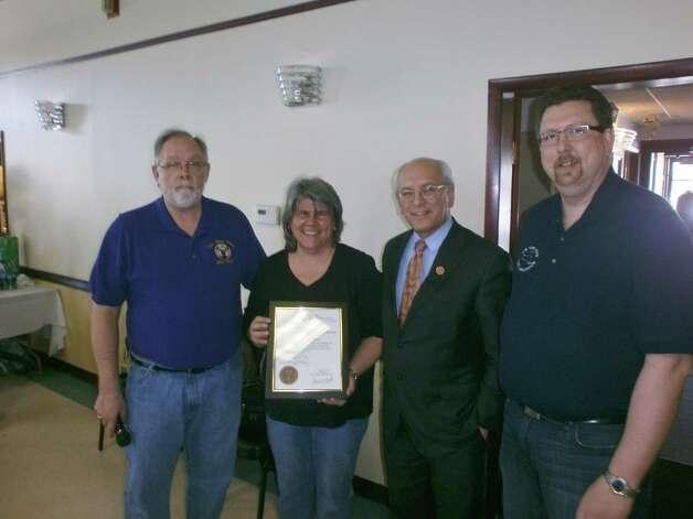 Susan Drescher was recognized March 9 as Elk of the Year by the Clifton Park Elks Lodge. The award is given annually to a citizen who has contributed to improving the community. She coordinated the shipment of care packages to troops overseas, Christmas gift bags for veterans at the VA & Ellis hospitals, and Thanksgiving meals for vets at the Guardian House, Ballston Spa. Here she stands with past Elks state president Michael Bloss, U.S. Rep. Paul Tonko and Tom Nealon, Clifton Park Elks Exalted Ruler. (Submitted photo)