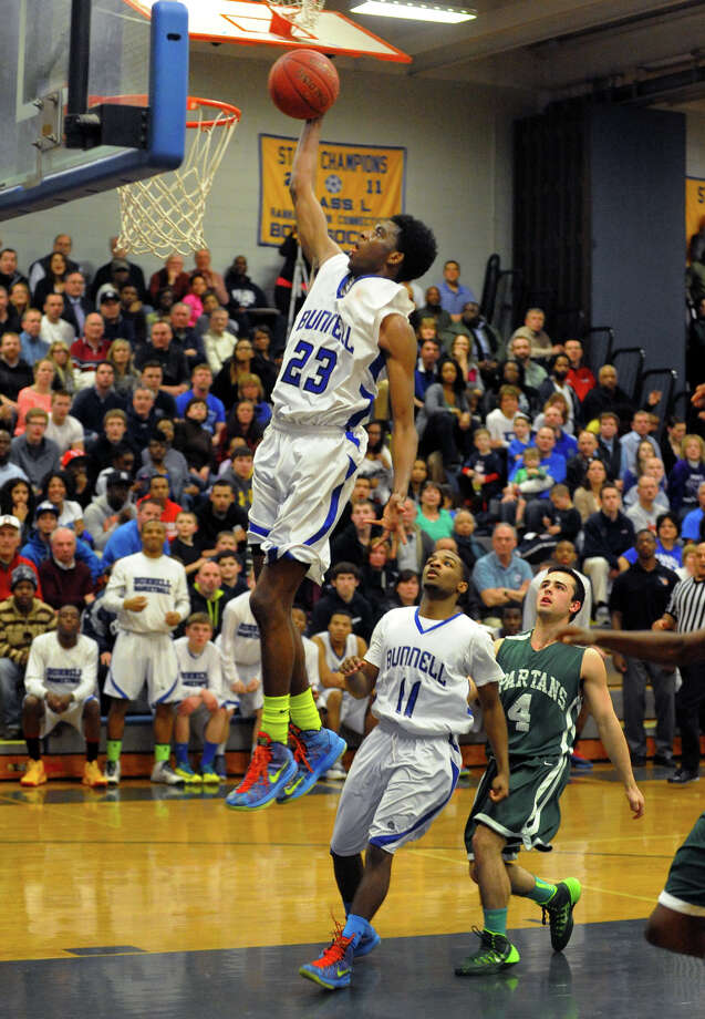 Bunnell's Isaac Vann flies to the basket, during Class L quarterfinal basketball action against Maloney in Stratford, Conn. on Friday March 14, 2014. Photo: Christian Abraham / Connecticut Post