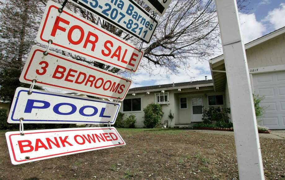 A foreclosure sign blows in the wind in early 2009 at a home under foreclosure in Antioch, Calif. Photo: Paul Sakuma, STF / AP