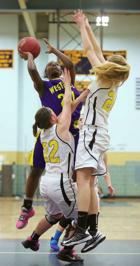 Westhill's Tyler Evans (20) shoots over South Windsor's Kristina Russo (22) and Alexandra Hill (24) during the Connecticut Class LL girls state basketball tournament game between Westhill High School and South Windsor High School, played at J.F. Kennedy High School, in Waterbury, Conn, on Friday, March 14, 2014. Photo: H John Voorhees III / The News-Times Freelance