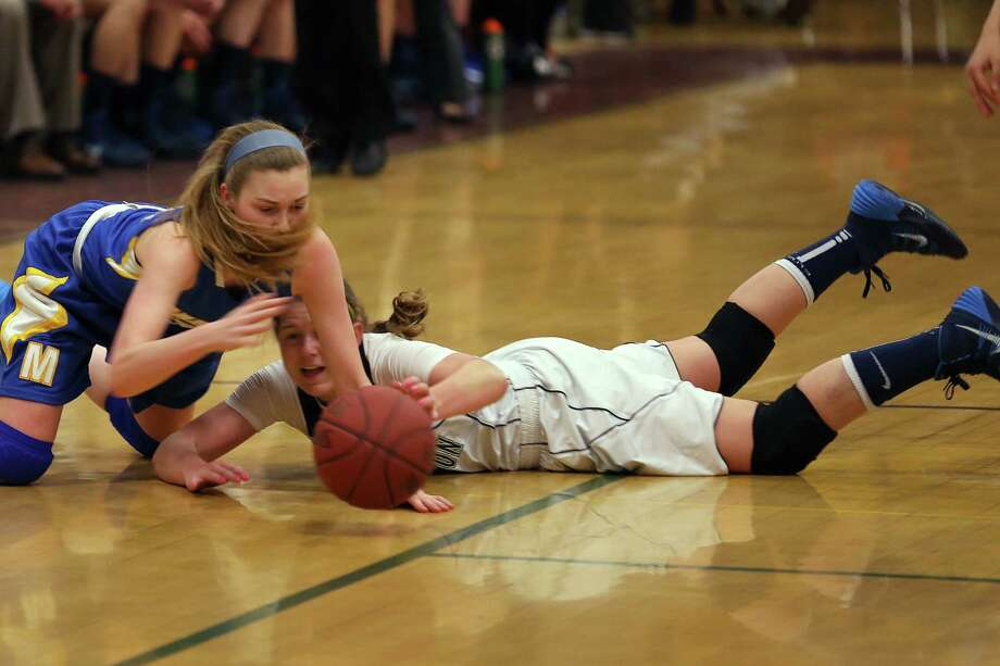 Lauralton Hall of Milford's #10 Carly Fabbri fights for a loose ball with Mercy of Middletown's #12 Hannah Coleman during Friday evening Class LL semi-finals. Lauralton Hall would win 52-43. Photo: Mike Ross / Mike Ross Connecticut Post freelance - @www.mikerossphoto.com