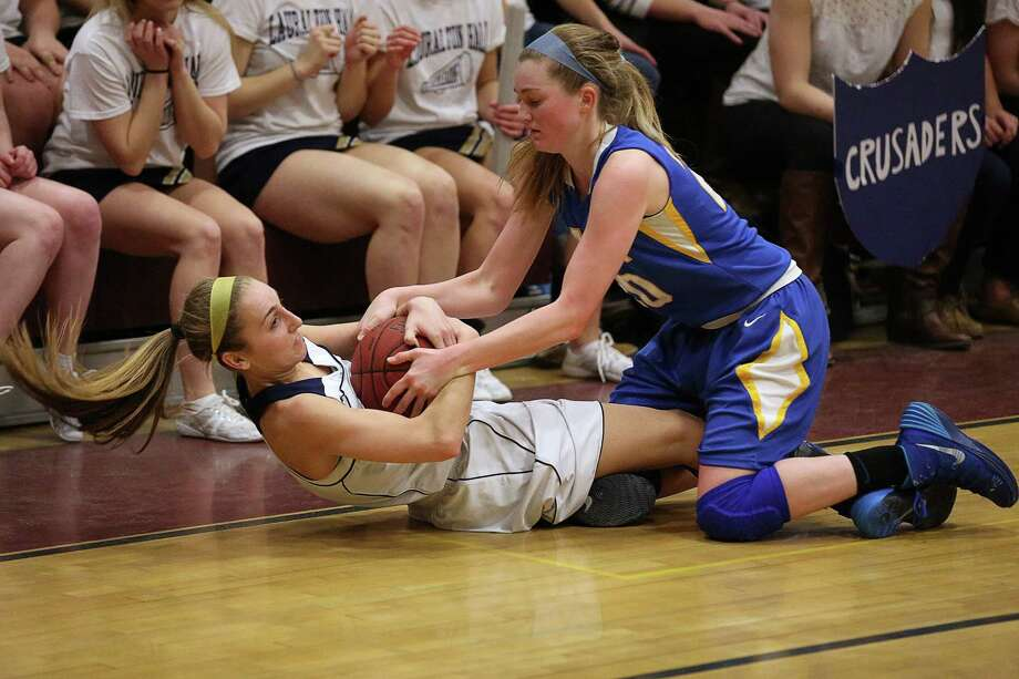 Lauralton Hall of Milford's #3 Maggie Salandra fights for a loose ball with a Mercy of Middletown defender during Friday evening Class LL semi-finals. Lauralton Hall would win 52-43. Photo: Mike Ross / Mike Ross Connecticut Post freelance - @www.mikerossphoto.com