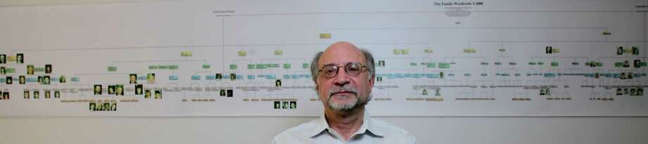 Bennett Greenspan, a partner in Gene by Gene, displays part of his genealogical map. He says when the company started, DNA testing was a mystery to most people. Photo: James Nielsen, Staff / © 2014  Houston Chronicle