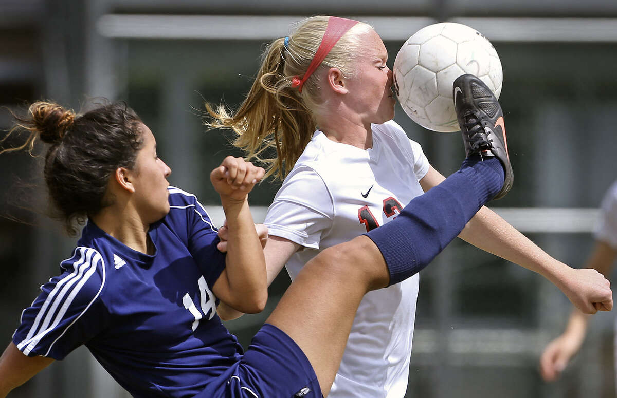 Roosevelt's Lisette Trujillo catches Churchill's Caroline Bowers with an inadvertent shot to the nose. The Rough Riders rallied from a 2-0 deficit and the game ended deadlocked, allowing Roosevelt to retain its playoff hopes.
