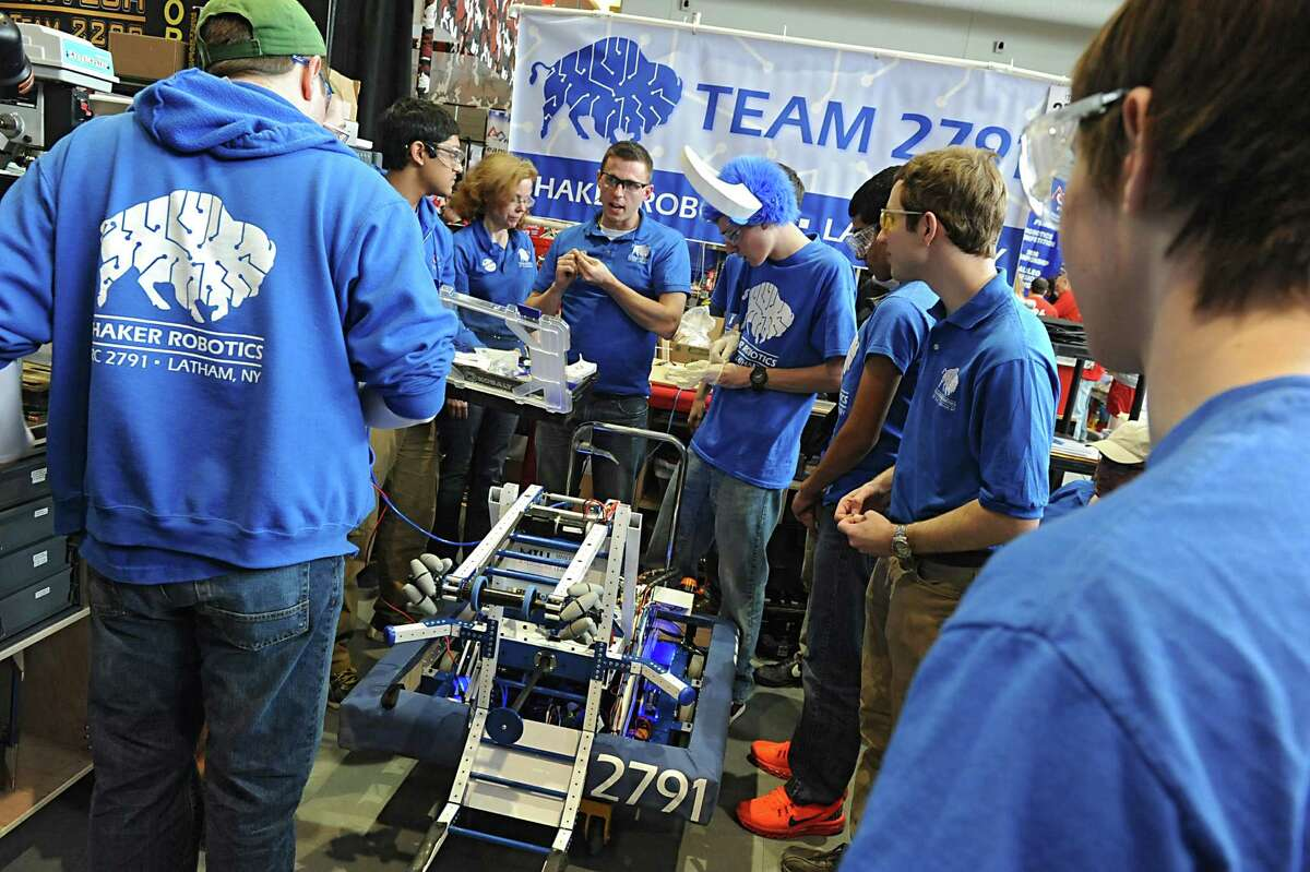 The Shaker High School robotics team takes out thei first aid kit to mend a problem with their robot while in the cockpit area during the New York Tech Valley Regional FIRST Robotics Competition held at RPI on Friday, March 14, 2014 in Troy, N.Y. Winners of this competition will go on to the championship in St. Louis. (Lori Van Buren / Times Union)
