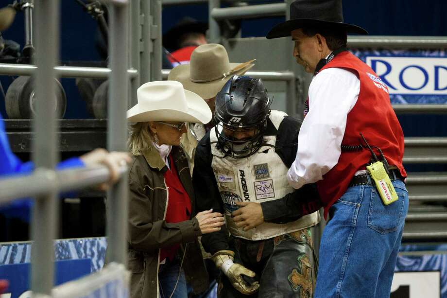 Craig Jackson is helped out of the arena by the sports medicine team after being hurt by a bull during the Bull Riding BP Super Series I, Round 2 competition, Wednesday, March 5, 2014, in Houston. Photo: Marie D. De Jesús, Houston Chronicle / © 2014 Houston Chronicle