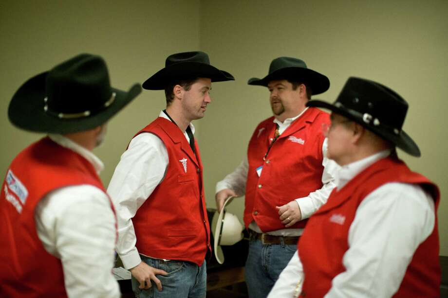 Members of the sports medicine team, Chris Whitten, left, Joshua Harris, Jace Duke and Peter Curka gather at the sports medicine clinic minutes before heading to the arena where they will treat any rodeo athlete in need of medical assistance, Thursday, March 13, 2014, in Houston. Photo: Marie D. De Jesus, Houston Chronicle / © 2014 Houston Chronicle