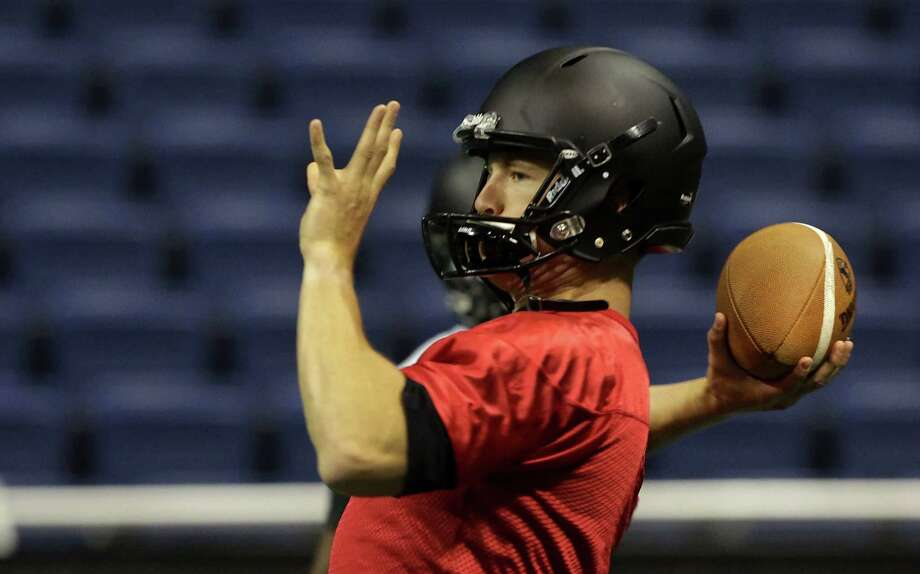 The San Antonio Talons quarter back Mitch Mustain picks a target receiver during a practice in the Alamodome, Friday March 14, 2014. Photo: San Antonio Express-News / © 2012 San Antonio Express-News