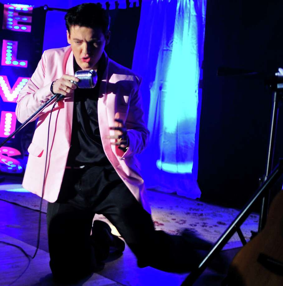 Nederland resident Jake Rowley, 18, performed his first live show as the American music giant - Elvis Presley - on Friday night at the County Seat Music Hall in Kountze. Photo by Cassie Smith/@smithcassie. March 14, 2014.