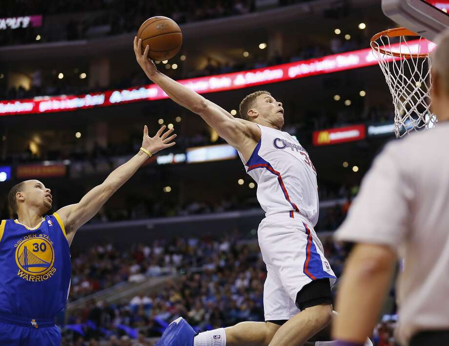 Blake Griffin turns a rebound into a powerful dunk Wednesday against the Warriors. Griffin has elevated his game and helped the Clippers become the hottest team in basketball. Photo: Danny Moloshok, Associated Press