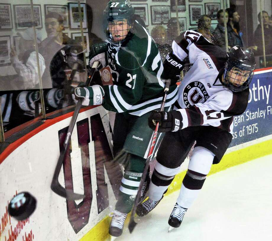 Dartmouth's # 27 Brandon Kirk, left, and Union's #17 Daniel Ciampini chase the puck behind the goal in Friday night's game March 14, 2014, in Schenectady,NY.   (John Carl D'Annibale / Times Union) Photo: John Carl D'Annibale / 00026092A