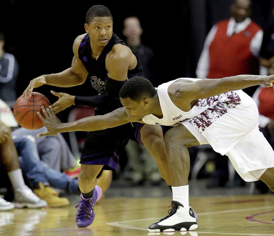 Alabama A&M's Brandon Ellis, right, knocks the ball from Prairie View A&M's John Brisco, left, during the first half of an NCCA college basketball game in the semifinals of the Southwestern Athletic Conference tournament Friday, March 14, 2014, in Houston. Photo: David J. Phillip, Associated Press / AP