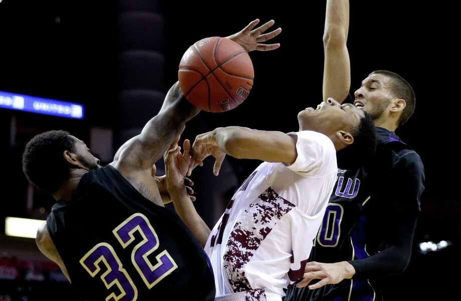 Alabama A&M's Nicholas West, center, has the ball knocked away by Prairie View A&M's Demondre Chapman (32) as Jules Montgomery, right, also defends during the first half of an NCCA college basketball game in the semifinals of the Southwestern Athletic Conference tournament on Friday, March 14, 2014, in Houston. (AP Photo/David J. Phillip) Photo: David J. Phillip, Associated Press / AP