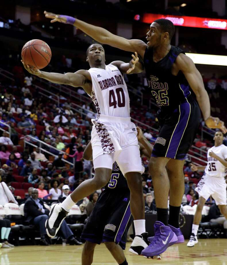 Alabama A&M's Brandon Ellis (40) goes up to shoot as Prairie View A&M's Reggis Onwukamuche (35) defends during the first half of an NCCA college basketball game in the semifinals of the Southwestern Athletic Conference tournament on Friday, March 14, 2014, in Houston.(AP Photo/David J. Phillip) Photo: David J. Phillip, Associated Press / AP