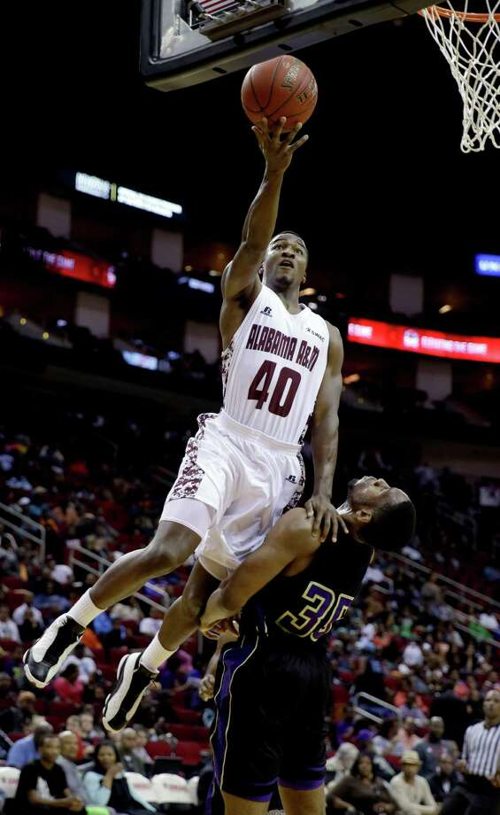 Alabama A&M's Brandon Ellis (40) goes up for a shot over Prairie View A&M's Reggis Onwukamuche (35) during the first half of an NCCA college basketball game in the semifinals of the Southwestern Athletic Conference tournament Friday, March 14, 2014, in Houston. Photo: David J. Phillip, Associated Press / AP