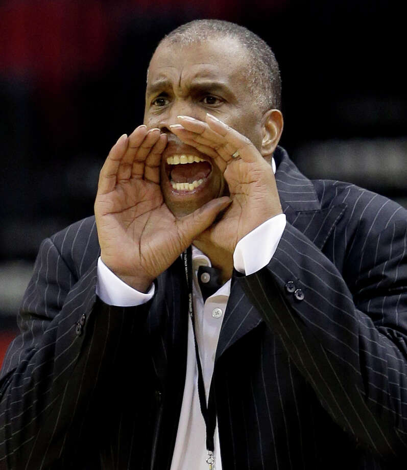 Texas Southern coach Mike Davis yells to his players during the second half of an NCAA college basketball game against Alabama State in the semifinals of the Southwestern Athletic Conference men's tournament Friday, March 14, 2014, in Houston. Texas Southern won 73-61. (AP Photo/David J. Phillip) Photo: David J. Phillip, Associated Press / AP