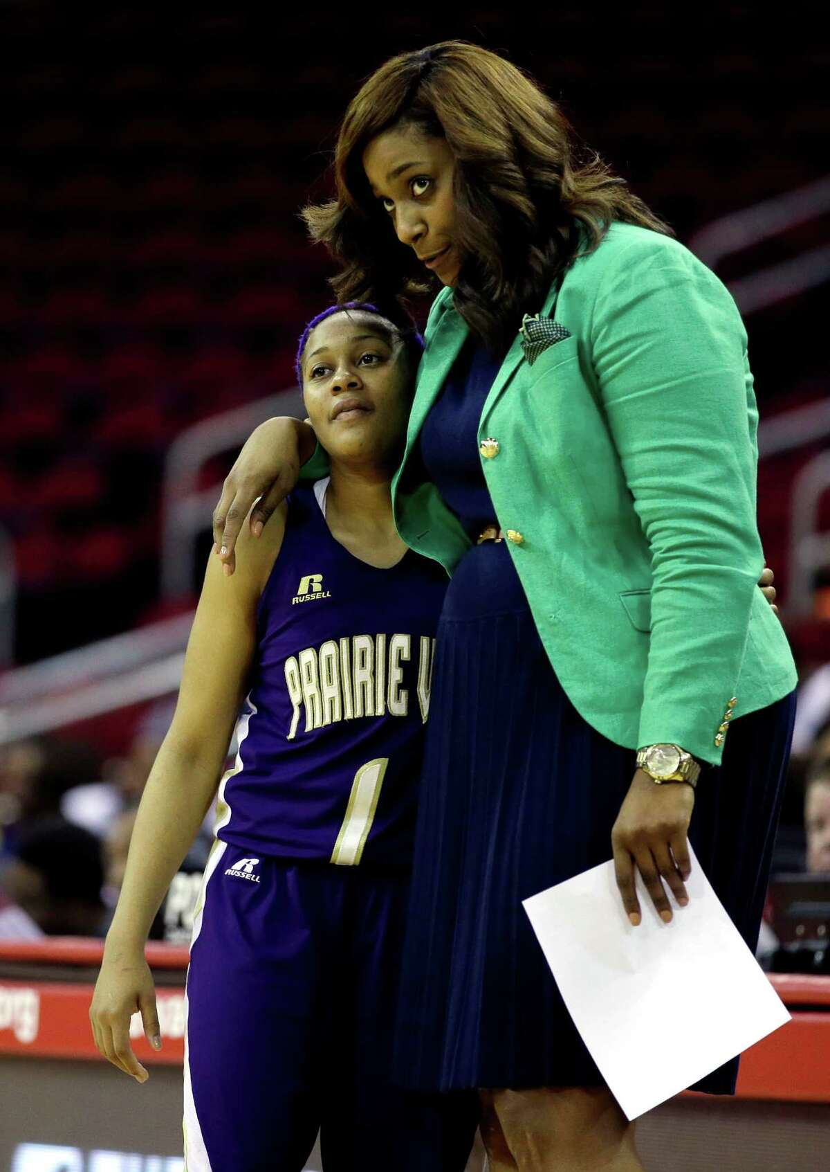 Prairie View A&M's Jeanette Jackson (1) gets a hug from her coach Dawn Brown after leaving the game during the closing minutes of the second half of an NCCA college basketball game against Southern in the semifinals of the Southwestern Athletic Conference tournament Friday, March 14, 2014, in Houston. Prairie View A&M won 72-43. (AP Photo/David J. Phillip)