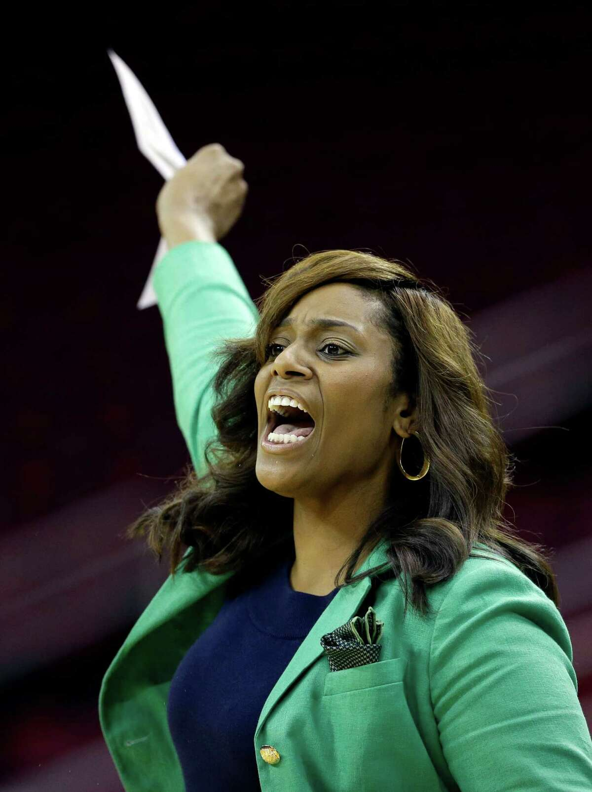 Prairie View A&M coach Dawn Brown calls a play against Southern during the first half of an NCCA college basketball game in the semifinals of the Southwestern Athletic Conference tournament on Friday, March 14, 2014, in Houston. (AP Photo/David J. Phillip)