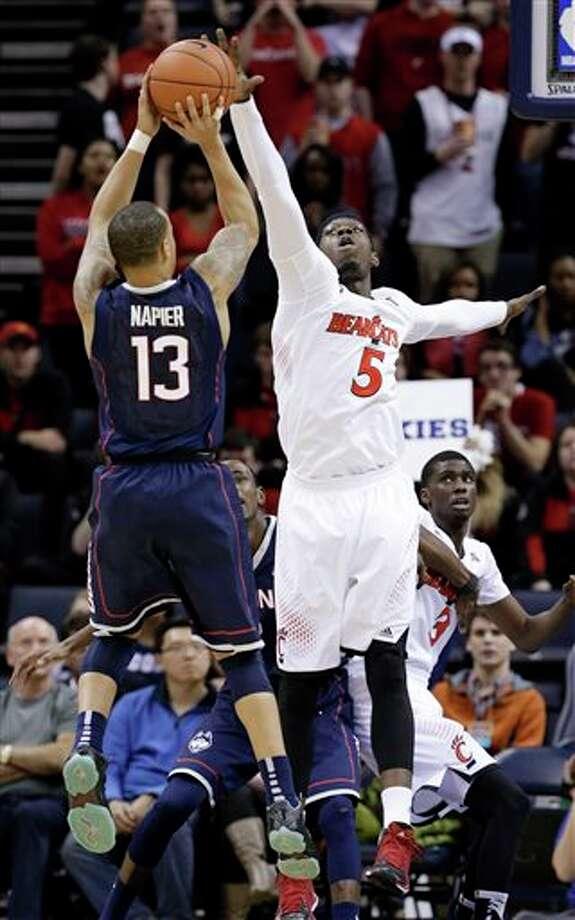 Cincinnati forward Justin  Jackson (5) blocks a shot by Connecticut guard Shabazz Napier (13)  during the second half of an NCAA college basketball game. (AP Photo/Mark Humphrey)
