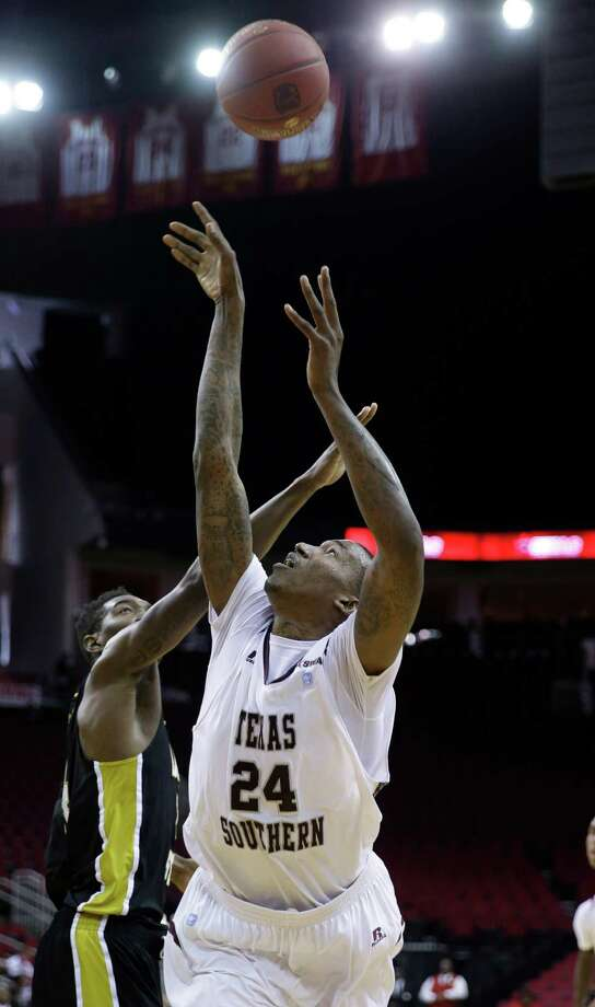 Texas Southern's Aaric Murray (24) is fouled by Alabama State's Tony Armstrong during the first half of an NCAA college basketball game in the semifinals of the Southwestern Athletic Conference tournament Friday, March 14, 2014, in Houston. Texas Southern won 73-61. (AP Photo/David J. Phillip) Photo: David J. Phillip, Associated Press / AP