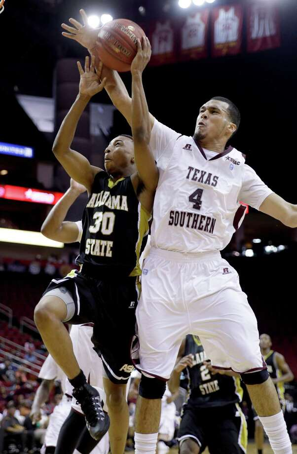 Alabama State's Terrance LeFlore (30) is fouled by Texas Southern's Jose Rodriguez (4) during the second half of an NCAA college basketball game in the semifinals of the Southwestern Athletic Conference tournament on Friday, March 14, 2014, in Houston. Texas Southern won 73-61. (AP Photo/David J. Phillip) Photo: David J. Phillip, Associated Press / AP
