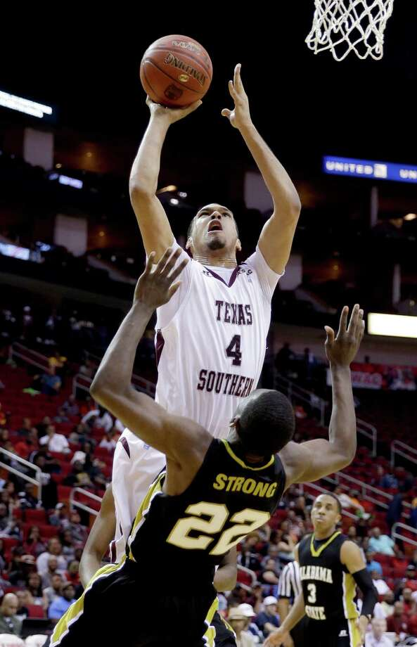 Texas Southern's Jose Rodriguez (4) charges into Alabama State's Maurice Strong (22) while shooting during the first half of an NCAA college basketball game in the semifinals of the Southwestern Athletic Conference tournament Friday, March 14, 2014, in Houston. Texas (AP Photo/David J. Phillip) Photo: David J. Phillip, Associated Press / AP