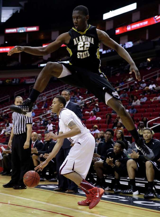 Alabama State's Maurice Strong (22) leaps while defending against Texas Southern's Lawrence Johnson-Danner during the first half of an NCAA college basketball game in the semifinals of the Southwestern Athletic Conference tournament on Friday, March 14, 2014, in Houston. (AP Photo/David J. Phillip) Photo: David J. Phillip, Associated Press / AP