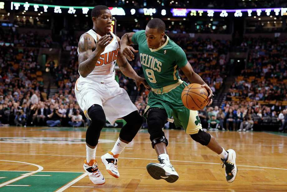 Boston Celtics guard Rajon Rondo (9) drives on Phoenix Suns' Eric Bledsoe during the first quarter of an NBA basketball game in Boston on Friday, March 14, 2014. (AP Photo/Winslow Townson) ORG XMIT: BXG101 Photo: Winslow Townson / FR170221 AP