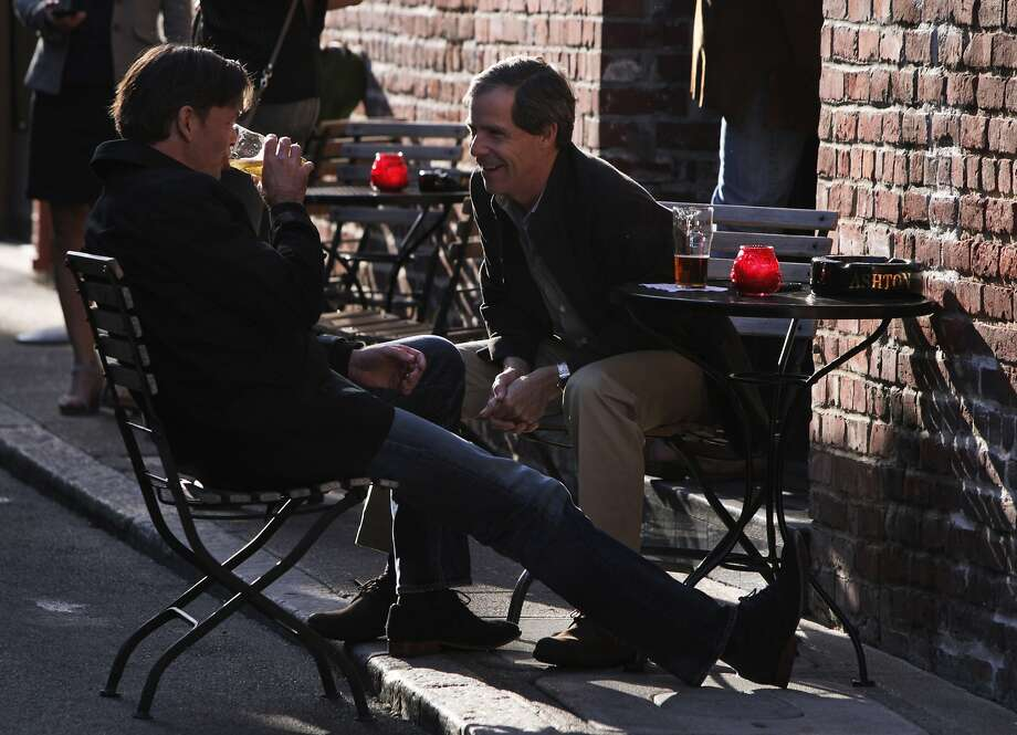 San Francisco natives Jack Poore (right) and Maurice Werdegar chat at Jackson Square. Photo: Andre Zandona, The Chronicle