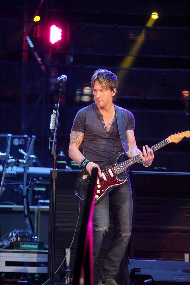Country star Keith Urban performs at RodeoHouston for the fifth time. Photo: Pin Lim, For The Chronicle