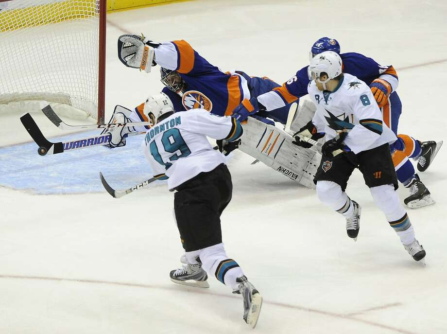 Joe Thornton shoots past Islanders goalie and longtime Shark Evgeni Nabokov to put San Jose up 3-1 in the second period. Photo: Kathy Kmonicek, Associated Press